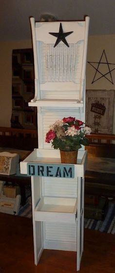 Would be a cute jewelry display for a show!  Repurposed shutter and chairs