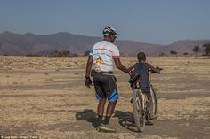 Early learner: Photos show one Maasai child, confidently taking to the saddle…