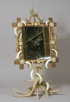 rare table mirror, carved wood frame decorated with antlers, wild boar tusks and carved horn roses