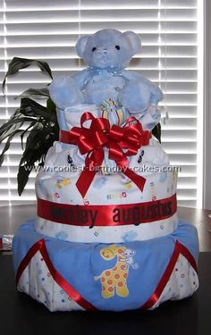 Blue Bear and Red Ribbon Diaper Cake... This website is the Pinterest of diaper cake ideas