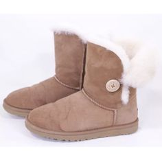 100% authentic UGG winter boots ☃ Ugg Bailey button tan winter boots. Pre owned in good condition! UGG Shoes Winter & Rain Boots