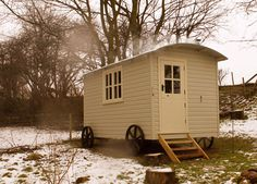 A shepherd's hut that serves as a bed and breakfast guest quarters in the UK. Wouldn't that make a fun farm stand?