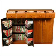 Hide the movies in a low-profile piece of furniture! It holds around 500 movies. (Not this color, though)