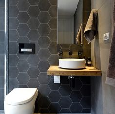 Pin This stunning bathroom features charcoal hexagon tiles and large rectangle concrete look porcelain tiles. The hexagon tiles add texture and warmth to the space. The Block Bathroom, Downstairs Bathroom, Laundry In Bathroom, Master Bathroom, Bathroom Wall, Tile For Small Bathroom, Charcoal Bathroom, Slate Bathroom, Tiny Bathrooms