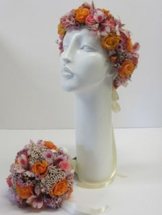 Wedding and Party Network | Floral headband and matching bouquet with a peach and orange palette.