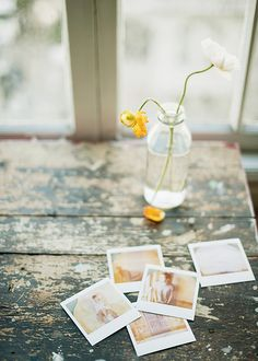 Scattered polaroids, glass bottles, wilted flowers and rustic tables - that pretty much sums up my day.