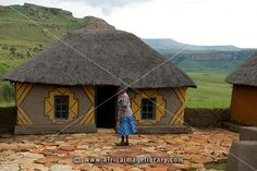 Photos and pictures of: Sotho woman in front of hut, Basotho Cultural Village, Golden Gate Highlands National Park, South Africa | The Africa Image Library