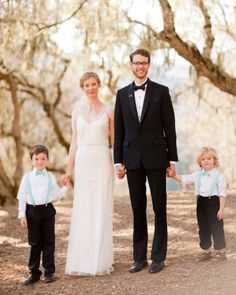 The Ring Bearers  Ring bearers Charlie and Leo posed for a portrait with bride and groom wearing matching teal and white gingham suspenders and bowties from MeandMatilda.