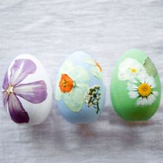 Terrain How-To: Pressed Flower Easter Eggs #shopterrain: wooden eggs painted with acrylic and decorated with dried, pressed flowers added with glue.