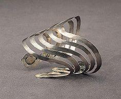 "Alexander Calder  Bracelet, c. 1942  Silver wire  3 11/16"" x 3 5/16"" x 3 1/16""  Calder Foundation, New York"