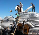EarthbagsBuilding.com -- constructing houses from sandbags or bags filled with local natural materials.
