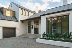 Transitional Exterior of Home with Raised beds, exterior stone floors