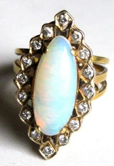 My mom had a 9 carrot opal that was bezel set., no diamonds.  It was custom make to her design.  She got the opal in Australia on a trip with my dad.