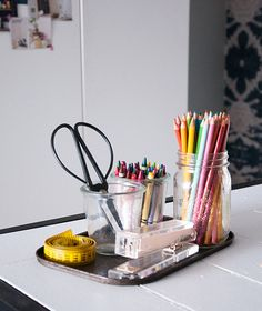 Organize your home office supplies by upcycling containers.