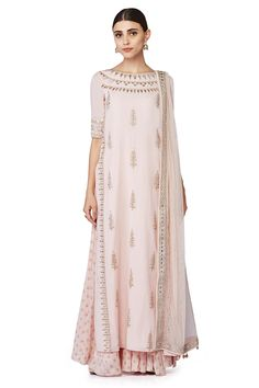 A beautiful pastel pink, straight style, gota patti detailed suit with a matching sheer dupatta and a printed sharara.INR 56,000.00