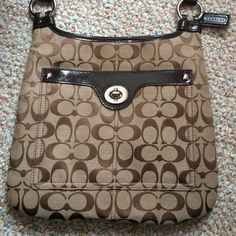Authentic Coach Cross Body Bag. Like new Coach cross body bag. Used twice, still has plastic lining along the outside silver clasp. Bag goes great with anything! Color : khaki and brown ( coach signature C's) Single adjustable strap. Clasp closure. Coach Bags Shoulder Bags