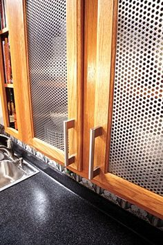 McNICHOLS® Perforated Metal inserts enhance a kitchen cabinet.