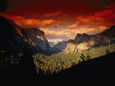 paul nicklen. scenic view of a sunset at yosemite national park.