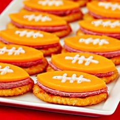 """""""Football Bites"""" -- a fun and easy appetizer with summer sausage, cheddar, crackers and ranch for game day!"""