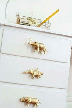 Switch knobs with spray painted toys for kids dresser