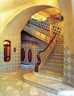 Casa Batlló.  Public stairway and gilded wrought iron column Another example of Gaudi's fondness for undersea themes. Architect Antoni Gaudí. Casa Batlló is a remodel of a previously built house. It was redesigned in 1904, Barcelona, Catalonia.