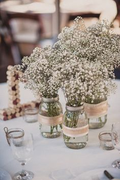 Baby's breath has a gentle country charm. Place them in mason jars wrapped in ribbon and burlap for full effect.