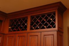 Remodeled kitchen with custom built-in wine rack by Neal's Design Remodel.