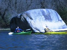 """The Caption """"Peter Hark and Gary Mogren paddle a pair of Kestrels near the largest rock in Rice Country, MN located on the Straight River North of Faribault. Having a day suitable to paddle in November is a real treat in Minnesota."""""""