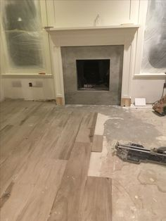 porcelain faux wood tiles being installed