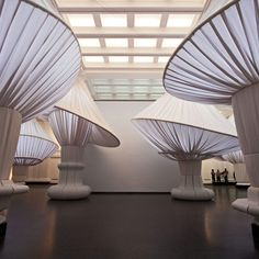 Billowing fabric mushrooms by New York designers Situ Studio have cropped up in the great hall of the Brooklyn Museum.