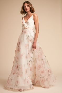 Jenny Yoo Collection, the Carolina bridal gown. Printed Floral Organza Wedding dress with painterly blossoms in subtle hues, this sleeveless gown features a plunging surplice V bodice that gives way to a voluminous A-line skirt. Perfect for a garden wedding. Available Exclusively at BHLDN x Jenny Yoo.