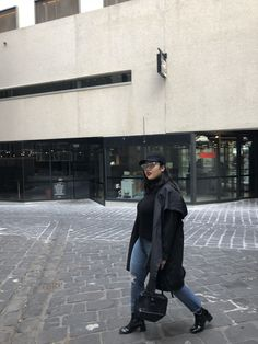 Techno black raincoat black cap patent black boots turtleneck
