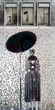 The collaborative project betweenStudio Wieki Somers,KvadratandAlexander McQueenin McQueen's Milan boutique. EntitledBlossom Rainfeatures three geisha warriors holding a series of lamps, against a blossom haze backdrop.