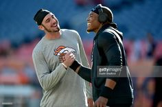 Quarterback Paxton Lynch #12 of the Denver Broncos and quarterback Cam Newton #1 of the Carolina Panthers shake hands before their game at Sports Authority Field at Mile High on September 8, 2016 in Denver, Colorado.