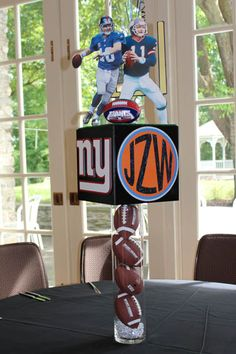 Sports Themed Photo Cube Centerpiece on Sports Ball Cylinders with Cutout Players - cube with flat top makes a great platform for additional elements - clear gems in base cover light element