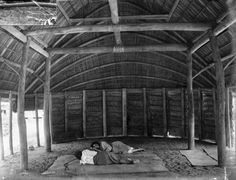 Inside a dwelling in Samoa showing interior architecture, sleeping mats and bamboo pillows. Taken in 1914.