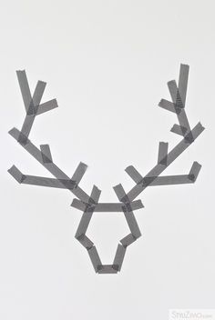 Stag's head from tape... paint a canvas in main colour, add tape, paint over with dark brown