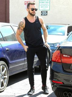 Tickets to the gun show: ArtemChigvintsev showed off his muscular biceps as he arrived to rehearsals in an all-black ensemble