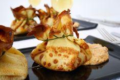 Fagottini di crêpes con ripieno di ragù di pesce