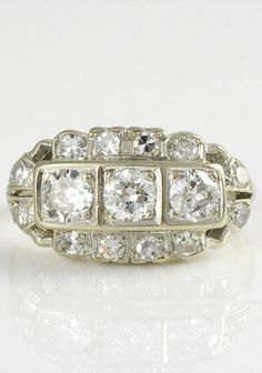 Vintage 0.93 carat total weight diamond ring, circa 1940. The ring is set in 14 karat white gold with three Old European cut diamonds at 0.60 carat total weight VS1-2 clarity G-H color and 12 accent diamonds at 0.33 carat total weight VS1-2 clarity G-H color, marked MW. Size 5. Appraised at $2,750.