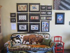 John Isaiah Pepion Ledger art above my favorite piece of furniture I ever made at Ranch-n-Roll!