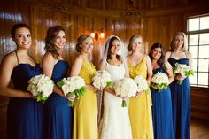 Mustard and navy maids dresses.