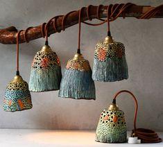 Ceramic pendant lights and pottery handmade by Madeline King on the Sunshine Coast Australia. Small batches of handmade ceramic lamp shades, ceramic lamps, pottery pendant lights, ceramic plant pots, ceramic bells and ceramic decor.