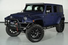 2014 Jeep Wrangler Unlimited in True Blue Metallic Kevlar Exterior: Front-Left View