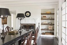 Love the Benjamin Moore Moonlight White 2143-60 with the black accents in the room.