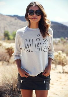 Julie Sarinana is wearing her own Mas, (More), Sweatshirts. Yeah, we'll buy it. :)