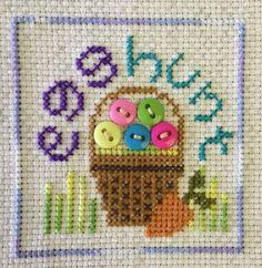 completed cross stitch Easter basket Egg Hunt
