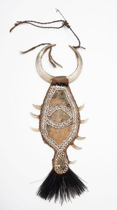 Papua (Indonesia) ~ Humboldt Bay   | Chest ornament (also served as a body shield to protect against arrow shots) | Tree bark, decorated with shells and boar tusks, natural fiber  | ca. 1892 or earlier