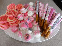 Sweet Tray for Baptism- Pink Pinwheel cookies, pink and white chocolate covered marshmallows, and pink and white chocolate covered pretzels, as well as caramel and chocolate covered pretzels.