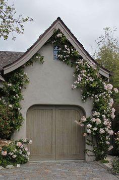 Climbing roses frame the garage